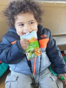 Westley enjoying a Plum Organics Squeezey Pouch