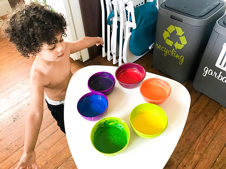 Once the different color are ready, let your toddler make the decision on what order to follow when pouring the batters into the cupcake holders.