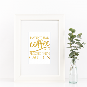 Free Printable Haven't Had Coffee proceed With Caution in gold from @pinkimonogirl for a gallery wall
